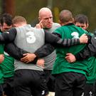 Paul O'Connell makes a point to the Irish players during yesterday's training session at Carton Housechalked