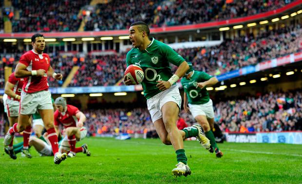 Ireland wing Simon Zebo runs in the first try during the RBS Six Nations game between Wales and Ireland at the Millennium Stadium in Cardiff, 2013