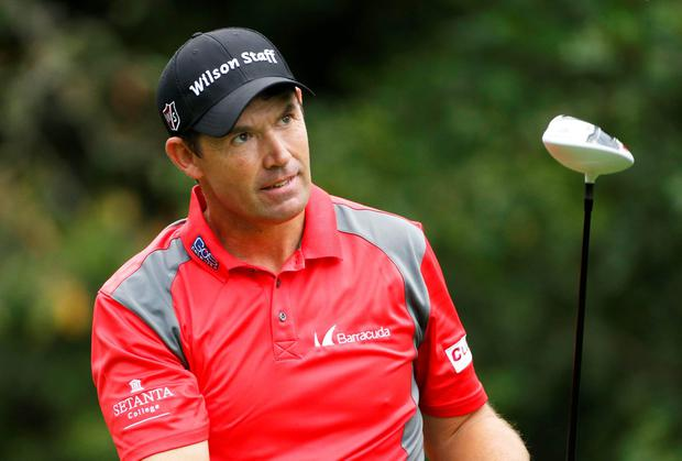 Padraig Harrington watches his tee shot on the 11th hole during first round action on the Copperhead Course during the Valspar Championship at Innisbrook Resort