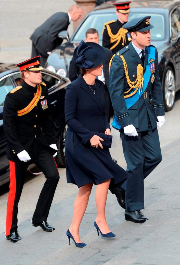 (LtoR) Britain's Prince Harry, Britain's Catherine, Duchess of Cambridge, and Britain's Prince William, Duke of Cambridge arrive ahead of a Service of Commemoration for those who served in Afghanistan at St Paul's Cathedral in central London
