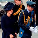 (LtoR) Britain's Catherine, Duchess of Cambridge, Britain's Prince Harry, and Britain's Prince William, Duke of Cambridge arrive ahead of a Service of Commemoration for those who served in Afghanistan at St Paul's Cathedral in central London