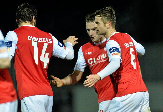 Christy Fagan, second from right, celebrates after scoring St Patrick's third goal with team-mates James Chambers, left and Greg Bolger.