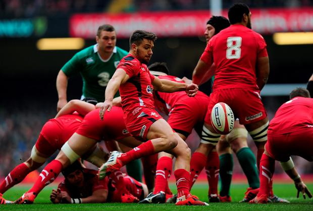 CARDIFF, WALES - MARCH 14: Rhys Webb of Wales puts in a box kick during the RBS Six Nations match between Wales and Ireland at Millennium Stadium on March 14, 2015 in Cardiff, Wales. (Photo by Dan Mullan/Getty Images)