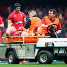 Samson Lee of Wales is stretchered off by medics during the RBS Six Nations match between Wales and Ireland at the Millennium Stadium