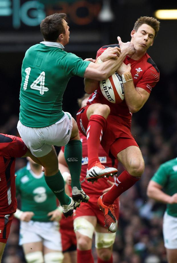 Rugby Union - Wales v Ireland - RBS Six Nations Championship 2015 - Millennium Stadium, Cardiff, Wales - 14/3/15 Wales' Liam Williams and Ireland's Tommy Bowe in action Reuters / Rebecca Naden Livepic EDITORIAL USE ONLY.