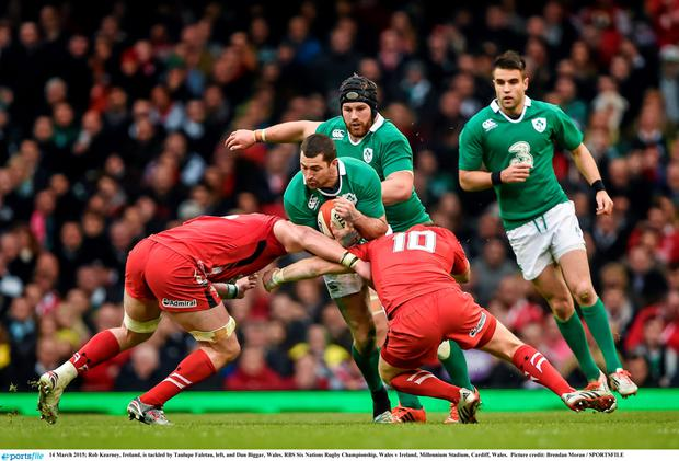 Rob Kearney is tackled by TobyFaletau and Dan Biggar during the 2015 Six Nations encounter