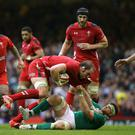 Wales' Alun Wyn Jones in action with Ireland's Jamie Heaslip