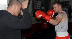 Box to box: Wayne Rooney has a long association with boxing