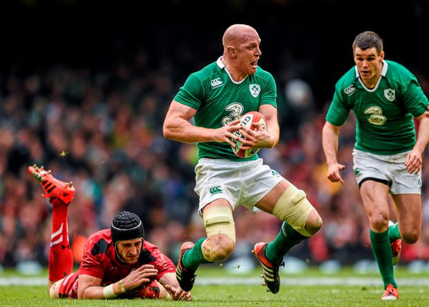 Ireland captain Paul O'Connell breaks the tackle of Wales' Luke Charteris at the Millennium Stadium on Saturday