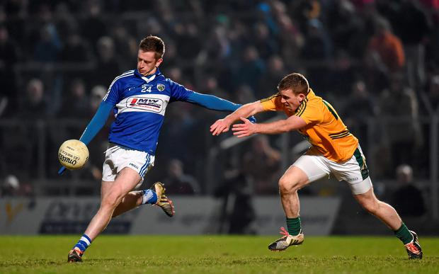 Paul Kingston, Laois, in action against Nicky Judge, Meath.
