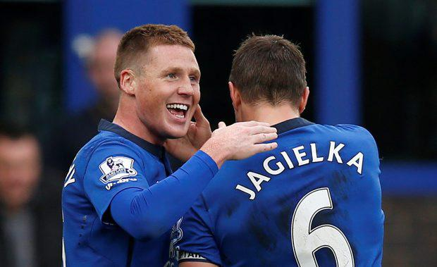 Everton's James McCarthy celebrates scoring their first goal with Phil Jagielka
