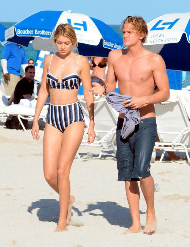 Gigi Hadid and Cody Simpson are seen on the beach in Miami Beach FL