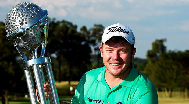 George Coetzee of South Africa holds the trophy for winning the Tshwane Open at Pretoria Country Club on March 15, 2015 in Pretoria, South Africa