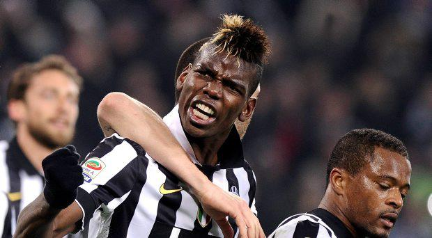 Juventus' Paul Lamine Pogba celebrates with his team mate Patrice Evra (R) after scoring