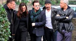 U2's Adam Clayton, The Edge, Bono and Larry Mullen with Ali Hewson at the funeral of their friend radio presenter Tony Fenton at Donnybrook Church in Dublin, where they sang 'Ordinary Love' from the altar.