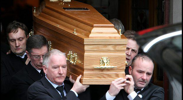 Mario Rosenstock and Ian Dempsey carry the remains while attending the funeral of DJ Tony Fenton which took place at the Church of the Sacred Heart in Donnybrook