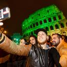 Tourists taking selfies in Rome on St. Patrick's Day.