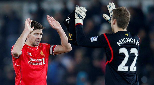 Liverpool's Steven Gerrard and Simon Mignolet celebrate victory