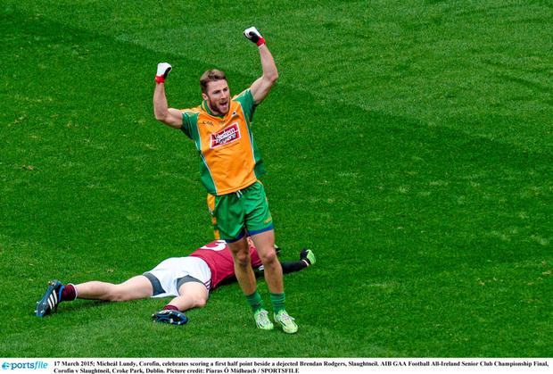 17 March 2015; Miche?l Lundy, Corofin, celebrates scoring a first half point beside a dejected Brendan Rodgers, Slaughtneil.