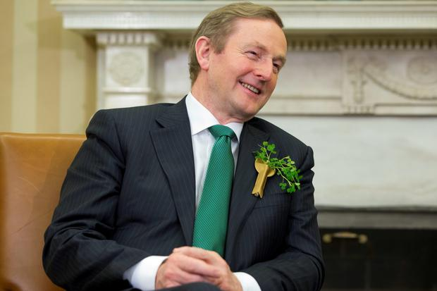 Irish Prime Minister Enda Kenny smiles during a meeting with President Barack Obama in the Oval Office of the White House in Washington, Tuesday, March 17, 2015. (AP Photo/Jacquelyn Martin)