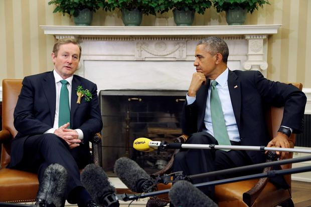 U.S. President Barack Obama (R) listens to remarks by Ireland's Prime Minister Enda Kenny after their meeting in the Oval Office as part of a St. Patrick's Day visit at the White House in Washington March 17, 2015. REUTERS/Jonathan Ernst