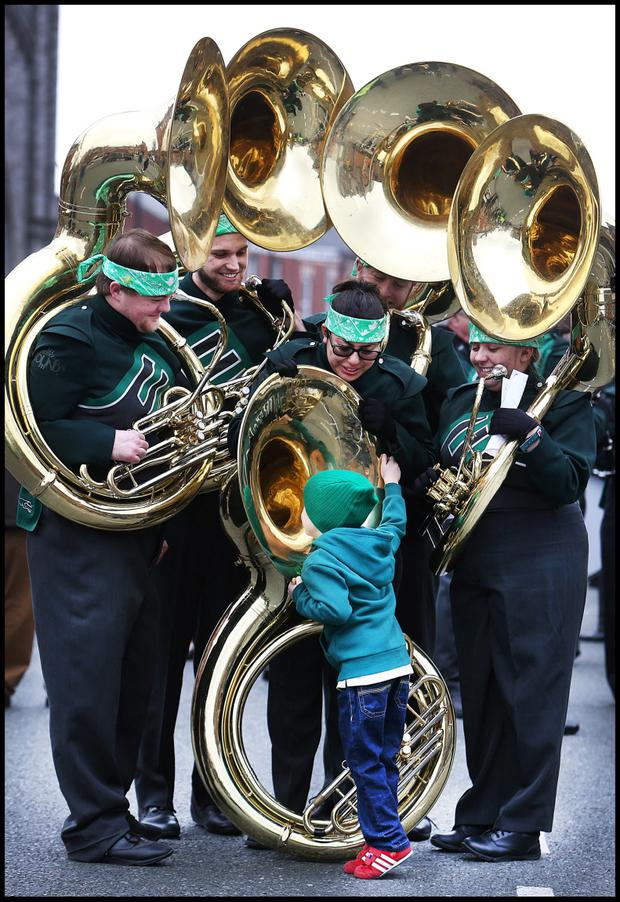 Enjoying the St Patricks Day Parade in Dublin was Daniel Moore (5) from Knocklyon taking a closer look at a Tuba from the Eastern New Mexico Greyhound Sound Band. Pic Steve Humphreys