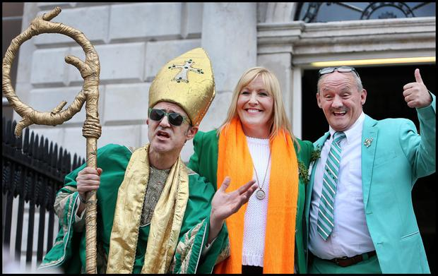 Grand Marshall Brendan O'Connor and wife Jennifer Gibney enjoying the St Patricks Day Parade in Dublin with St Patrick. Pic Steve Humphreys