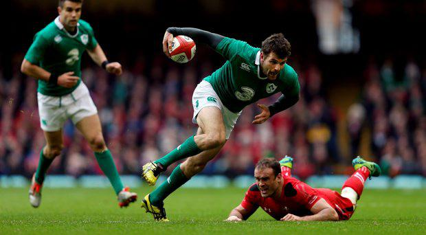 Ireland's Jared Payne gets past Wales Jamie Roberts during the RBS 6 Nations match at the Millennium Stadium, Cardiff