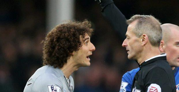 Newcastle's Fabricio Coloccini is shown a red card and is sent off by referee Martin Atkinson