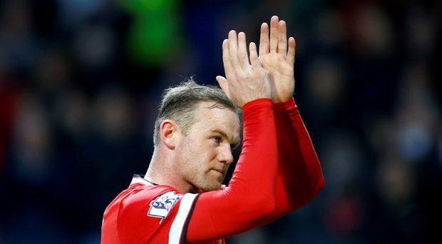 Manchester United's Wayne Rooney applauds the fans at the end of the match