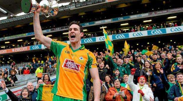 17 March 2015; Michael Farragher, Corofin, celebrates in front of supporters with the trophy. AIB GAA Football All-Ireland Senior Club Championship Final, Corofin v Slaughtneil, Croke Park, Dublin. Picture credit: Cody Glenn / SPORTSFILE