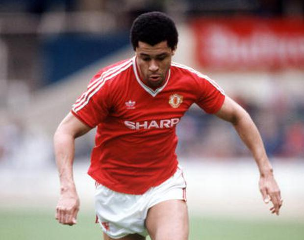 Paul McGrath in action for Manchester United