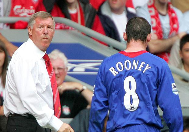 Manchester United's Wayne Rooney (R) is taken off by Alex Ferguson during their English Premier League soccer match against Liverpool at Anfield in 2005