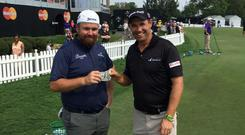 Shane Lowry hands over the money