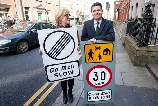 Moyagh Murdock, chief executive of the Road Safety Authority and the Minister for Transport, Paschal Donohoe, with the new road signs