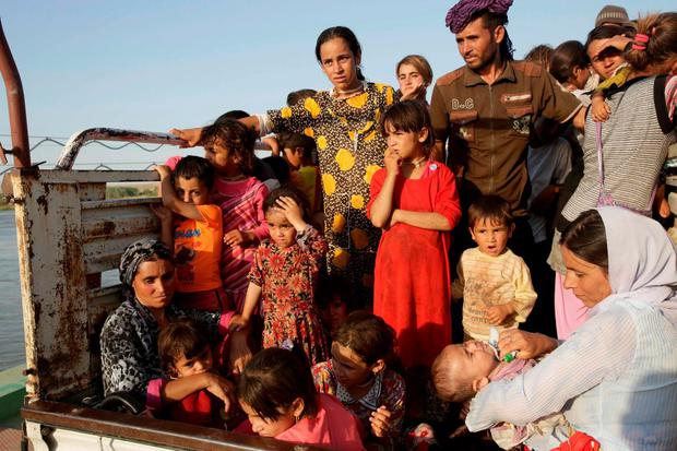 Displaced people from the minority Yazidi sect on the run from Isil near the Syrian border. Photo: Reuters
