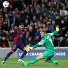 Neymar vies with Manchester City goalkeeper Joe Hart during Champions League tie at the Camp Nou