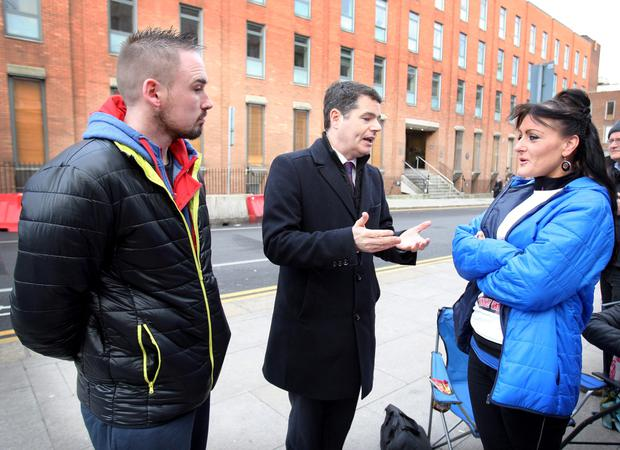 Paschal Donohoe,TD,the Minister for Transport,,Environment and Local Government with Christoper and Roseann Brennan, from Lintown Groves, Kilkenny whose six-year old son Jake died following an accident whilst playing outside his home on June 12, 2014. Photo: Tom Burke