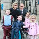 The Costello Family - L-R: Pat, Mary (mum), Gerard (dad), (In Wheelchair) Tadgh, Kate and Grace Pic: Courts Collins