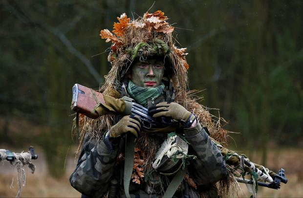 Damian Trynkiewicz carries his weapon during territorial defence training organised by SJS Strzelec Credit: Kacper Pempel