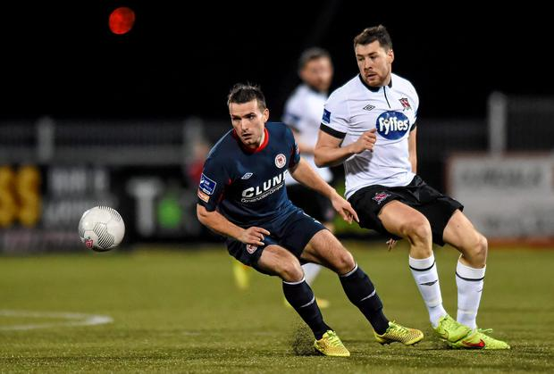 Christy Fagan, St Patrick's Athletic, in action against Brian Gartland, Dundalk