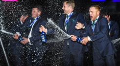 Ian Madigan, Jamie Heaslip and Robbie Henshaw celebrate after winning the RBS Six Nations Rugby Championship.
