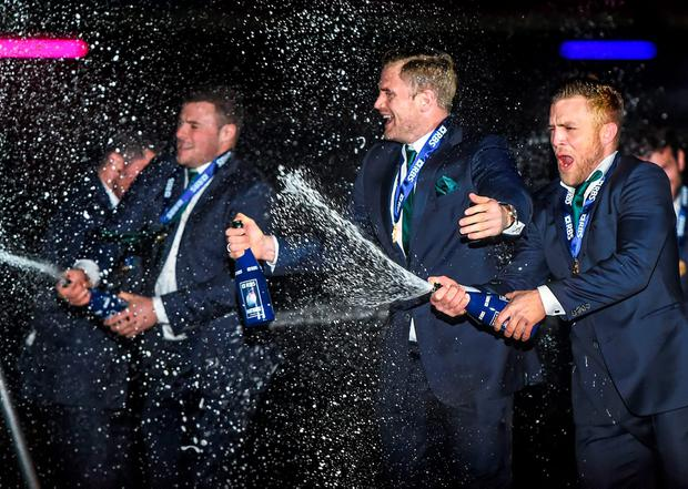 Ian Madigan, Jamie Heaslip, and Robbie Henshaw celebrate after winning the RBS Six Nations Rugby Championship