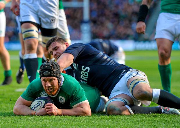 Sean O'Brien, Ireland, scores his side's second try against Scotland