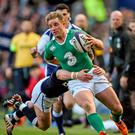 Luke Fitzgerald is tackled by Stuart Hogg, Scotland