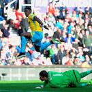 Wilfried Zaha of Crystal Palace beats goalkeeper Asmir Begovic of Stoke City to score their second goal