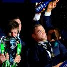 Ireland captain Paul O'Connell with the Six Nations Trophy (left), as Jamie Heaslip sprays his team with champagne as Ireland win the Six Nations at Murrayfield Stadium at the end of the 2015 RBS Six Nations match at the BT Murrayfield Stadium, Edinburgh