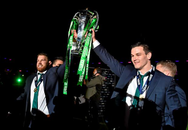Ireland's Sean O'Brien and Jonathan Sexton celebrate with the RBS Six Nations Rugby Championship trophy