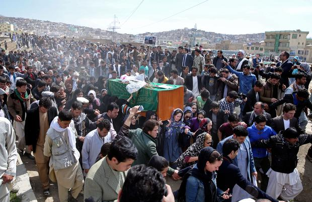 Afghan women rights activists carry the coffin of 27-year-old Farkhunda, an Afghan woman who was beaten to death by a mob, during her funeral, in Kabul, Afghanistan, Sunday, March 22, 2015. (AP Photo/Massoud Hossaini)