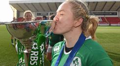 Ireland captain Niamh Briggs celebrates with the Women's Six Nations Rugby Championship trophy.